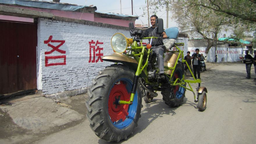 A man in Manas county, in Xinjiang, drives a motorcycle he made from scrap parts and a second-hand engine. Reuters/China Daily