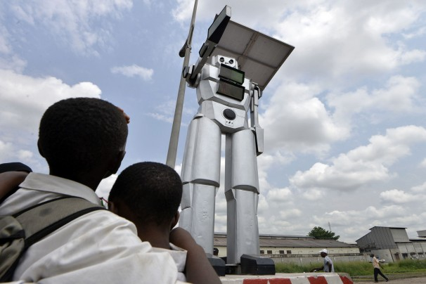 giant robot traffic cop in Congo