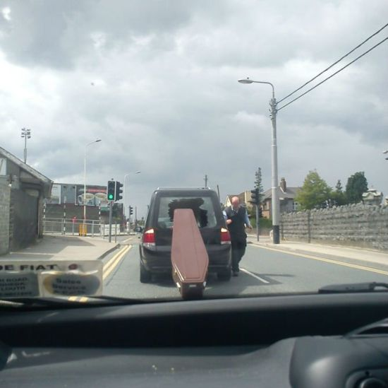 funeral corpse casket accident oops funny