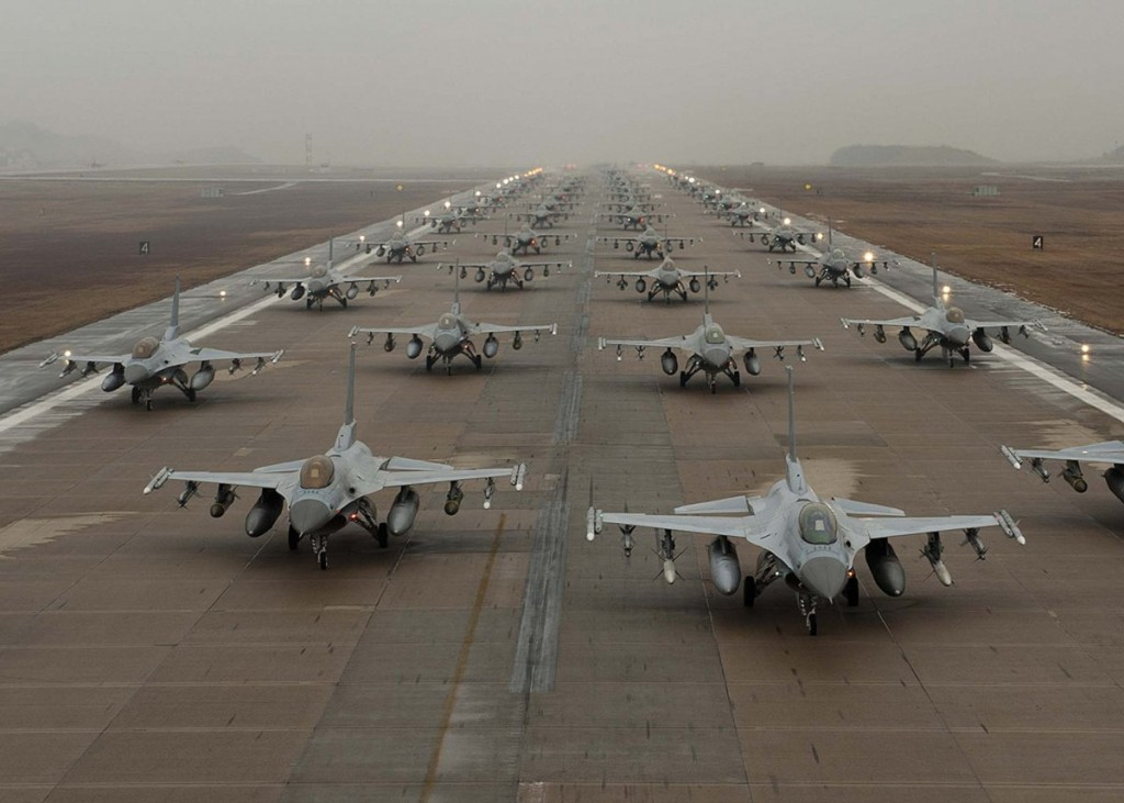 F-16 Fighting Falcons taxi down the flightline at Kunsan Air Base, South Korea